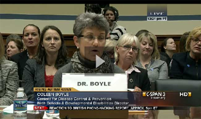Photo of Dr. Boyle in front of hearing panel.